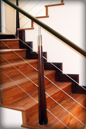 Wooden hand rails are not only a safety feature on any wooden stair case, but also asteatically pleasing.