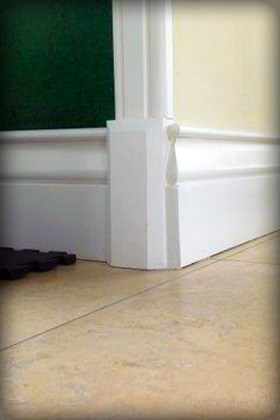 Plinth blocks are used at the floor below the door casing to create a visually pleasing transition to the baseboard.